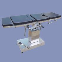 Universal operating table / hydraulic / tilting / lifting