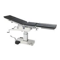 Universal operating table / hydraulic / height-adjustable