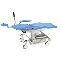 Ophthalmic surgery table / electric / height-adjustable / on casters