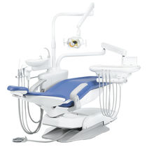 Dental treatment unit with hydraulic chair / with delivery system / with light