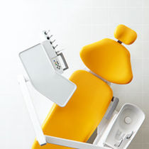 Dental treatment unit with hydraulic chair / with delivery system