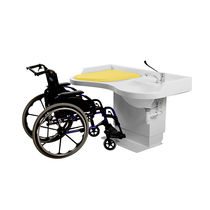 Handicapped changing station / with integrated hand basin / with bath