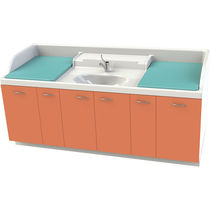 Nursery changing station / with storage boxes / with sliding trays / with washbasin