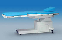 Tilting C-arm table / electrical