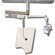 X-ray radiation shielding screen / ceiling-mounted / with halogen surgical lamp