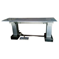 Height-adjustable radiography table
