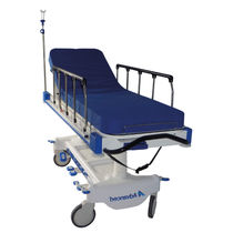 Transport stretcher trolley / hydraulic / height-adjustable / 2-section