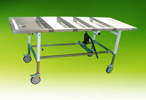 Embalming table on casters / height-adjustable / hydraulic