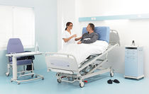 height-adjustable electric home care bed (4 sections, on casters) Medicalys ® II Winncare Group