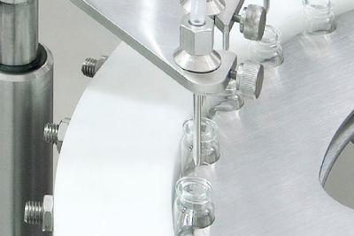 liquid filler / automatic / intermittent-motion / in-line