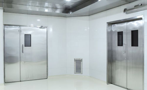 swing door / operating room / for radiation therapy / stainless steel