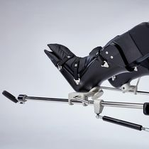 Operating table boot stirrup / examination table