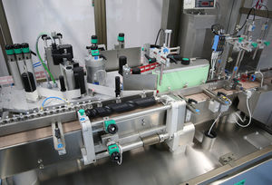 bottle labeling machine / for conveyor belts / automatic / linear