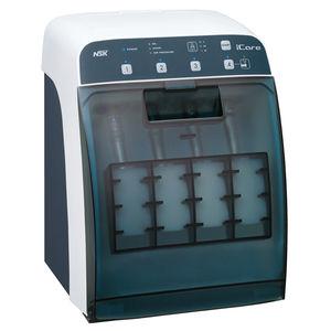 compressed air cleaner for dental instruments