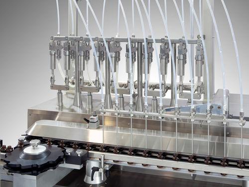 liquid filler / servo-driven / floor-standing / for the pharmaceutical industry