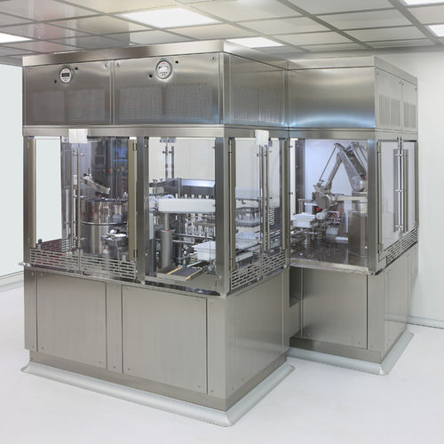 syringe filling and closing machine / rotating