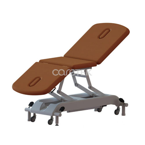 manual examination table / height-adjustable / 3-section