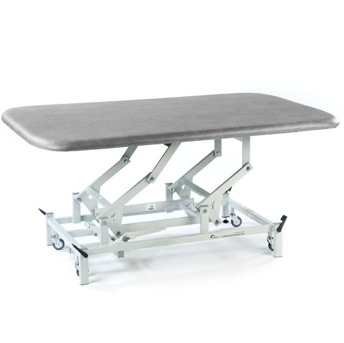 physiotherapy treatment table / electric / height-adjustable / on casters