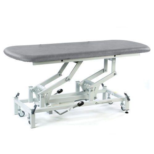 physiotherapy treatment table / hydraulic / height-adjustable / on casters