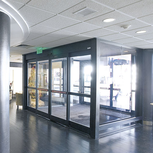 sliding door / for healthcare facilities / with glass panel / aluminum