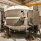 proton therapy synchrocyclotron with integrated CT scanner