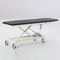 electric examination table / height-adjustable / on casters / 2-section