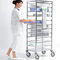 transport trolley / for sterilization baskets / with shelf / stainless steel
