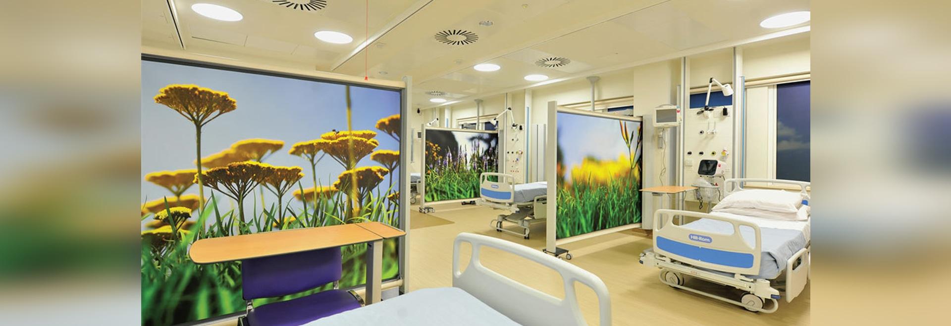 Hospital privacy screens on wheels KwickScreens at hospital ward in The National Hospital for Neurology and Neurosurgery, London.