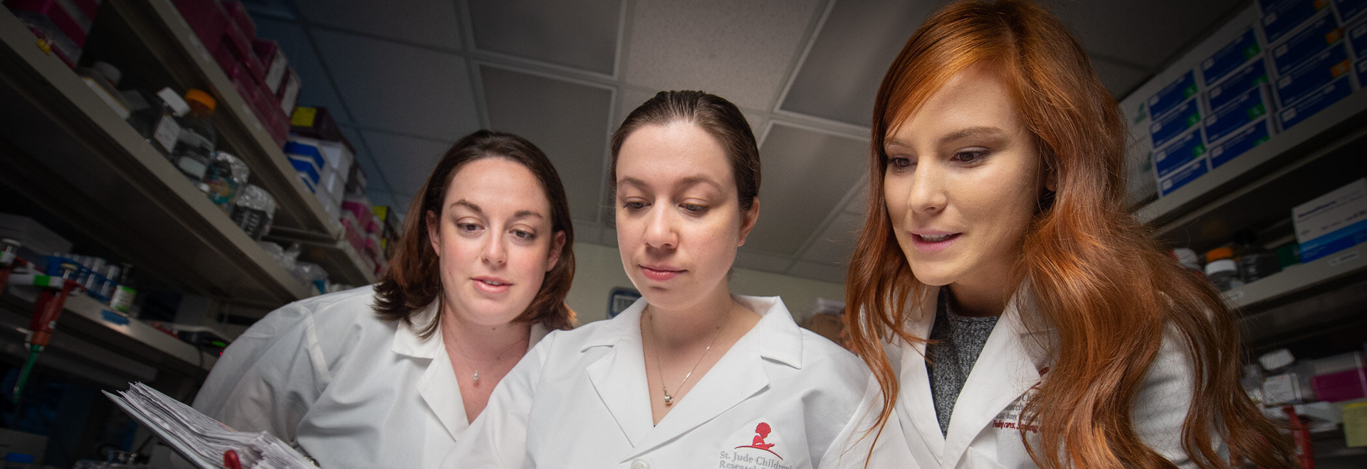 St. Jude scientists have used a 3D genome to improve understanding of gene regulation during development and disease. Pictured here, left to right, are Jackie Norrie, PhD; Marybeth Lupo, PhD; and V...