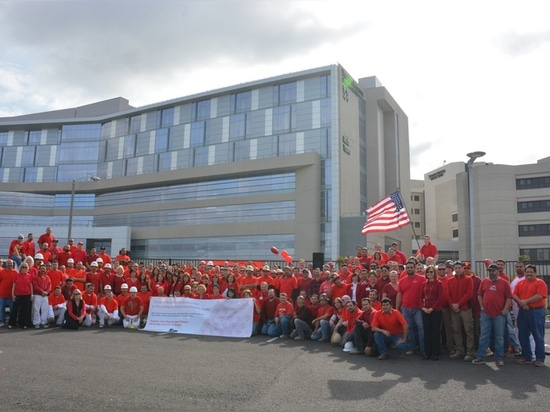 Construction workers from McCarthy Building Companies and other project team members on the Lundquist Tower construction site joined with Torrance Memorial Medical Center staff who wore red and che...