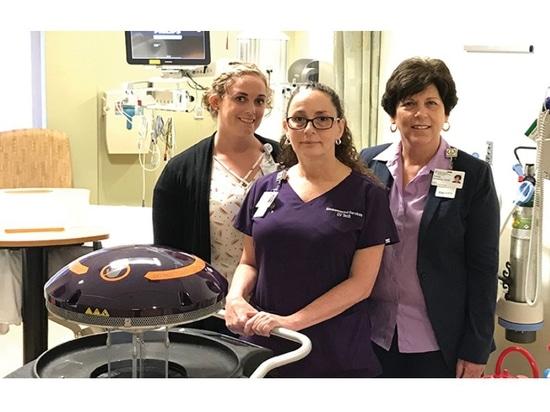 From left: Andrea Brown, EVS training supervisor; Patricia Mullins, UV technician; and Debbie Sandberg, EVS director.
