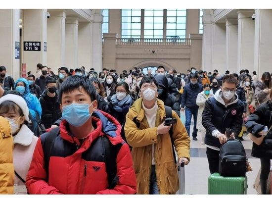 People wear face masks as they wait at Hankou Railway Station on Jan. 22, 2020, in Wuhan, China, where the new coronavirus 2019-nCoV originated.