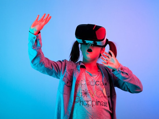 Amazed young girl experiencing virtual reality.
