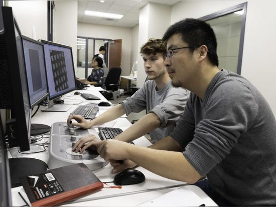 Nianshuang Wang, research associate, right, and Daniel Wrapp, graduate student, left, review cryo-EM images in The Sauer Structural Biology Laboratory Monday, February 17, 2020 at The University of...