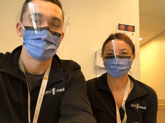 Second-year medical students Chris Momskal and Diana Craig volunteer in the University of Manitoba's COVID-19 efforts.