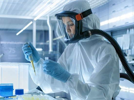 Laboratory worker, wearing a Powered Air-Purifying Respirator (PAPR).