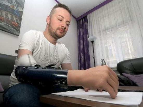 Writing with a prosthetic hand.