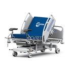 cama de parto / manual / de altura regulável / com rodízios